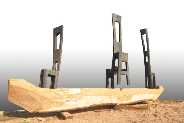 Jems Koko Bi, Passengers, 2012, 400 x 600 x 80 cm, oak wood partially burnt. Courtesy Galerié Cécile Fakhoury