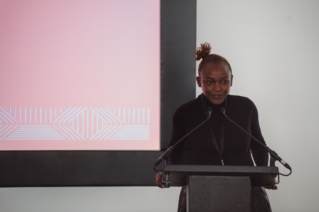 Koyo Kouoh, Curator FORUM Programme 1:54, delivering the Opening Remarks, 1:54 FORUM, Thursday 15 October 2015, London. Image Courtesy of 1:54 © Benjamin Hoffman