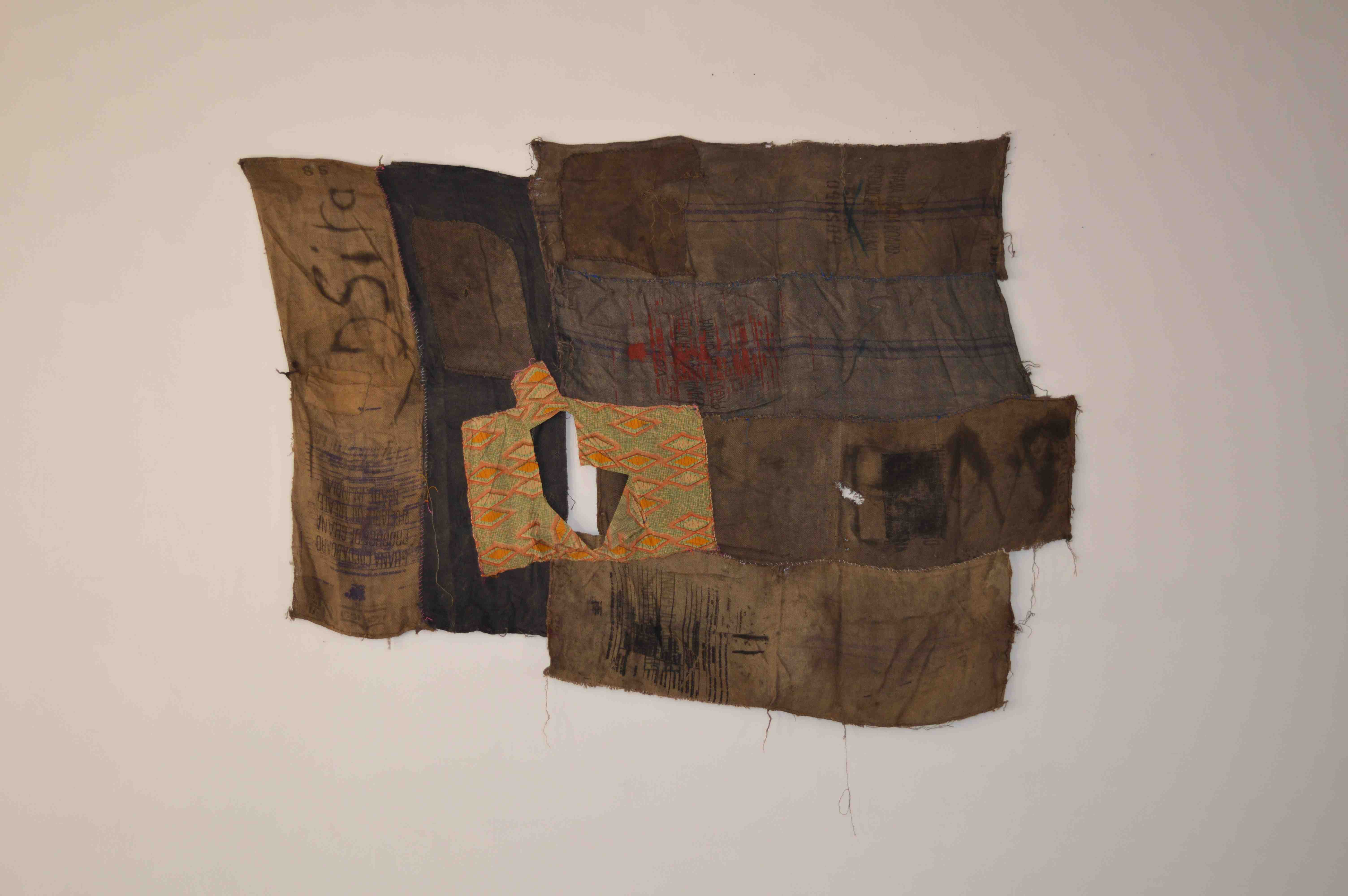 Ibrahim Mahama, Dsiya, 2015, Wax print and coal sacks on dyed sacks and coal sacks with screen prints and markings, 250  × 350  cm, Courtesy the artist and Modern Forms