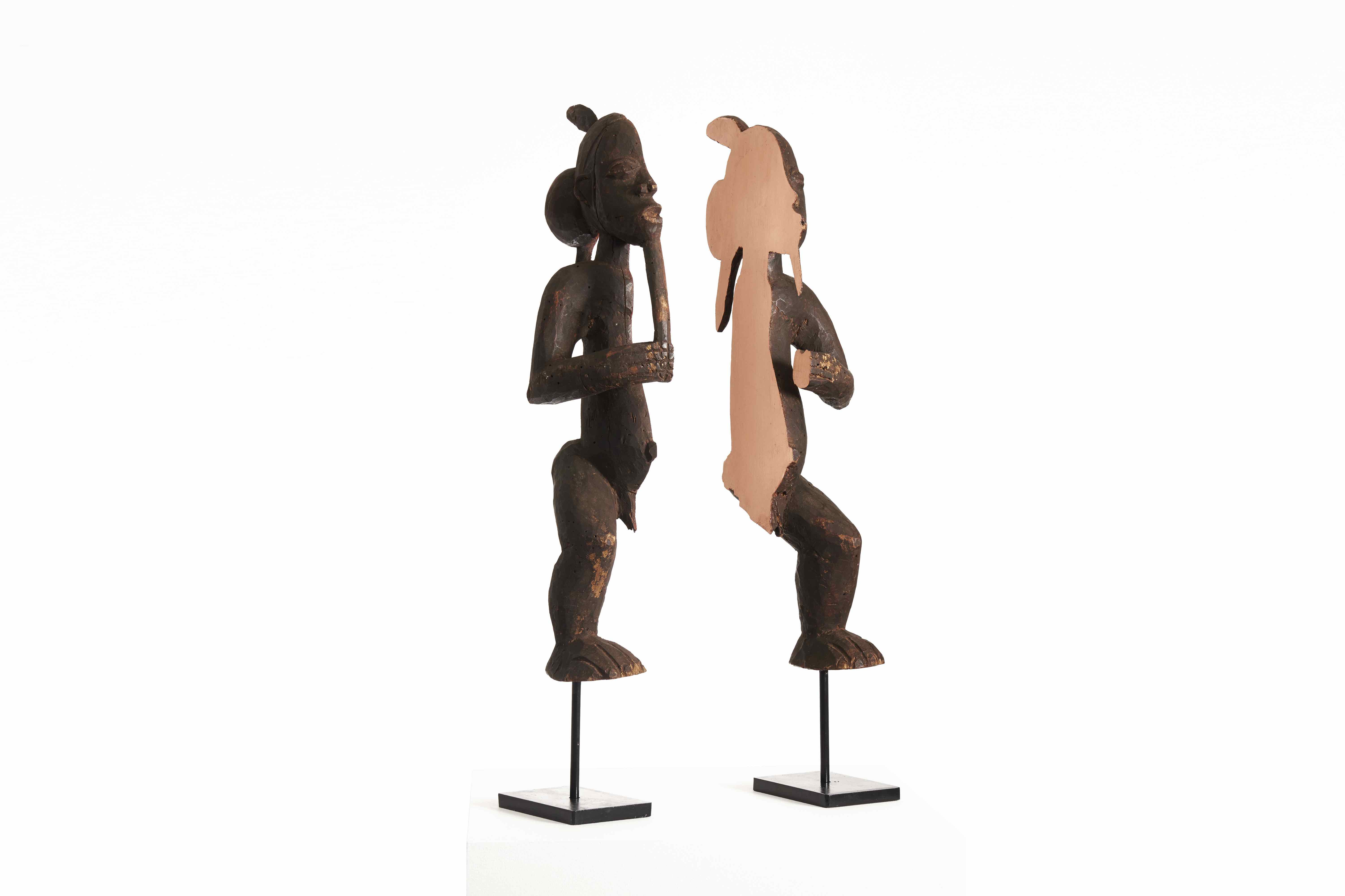 Niyi Olagunju, Lega III, 2016, Bisected wood sculpture, aluminum and copper foil, set on black patinated steel stand, Approx. 63 x 11 x 20 cm (each) / 25 x 4 x 8 in, Courtesy TAFETA